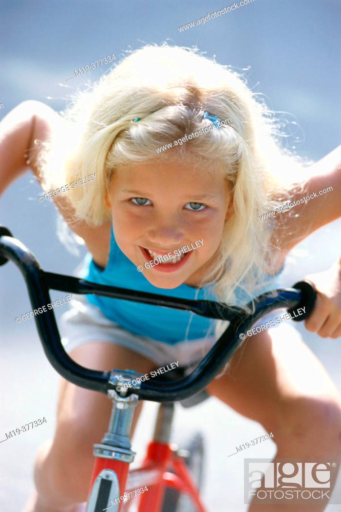 Stock Photo: girl on a bicycle.