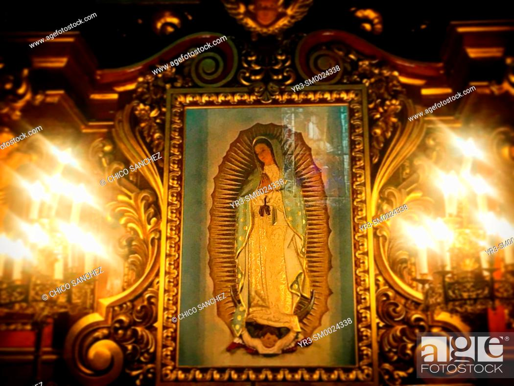 Stock Photo: An image of Our Lady of Guadalupe surrounded by candles decorates the church of Santa Rosa de Lima in Condesa, Mexico City, Mexico.