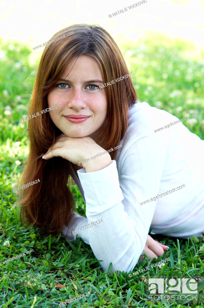 Stock Photo: Close-up of young woman with red hair.