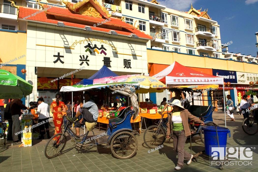 Stock Photo: China, Yunnan, Xishuangbanna, Menghai, rickshaw.