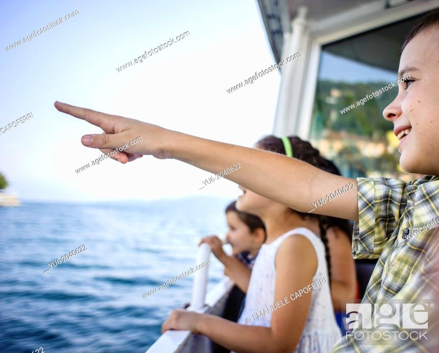 Stock Photo: Children navigate on the steamer on Lake Maggiore, Italy.