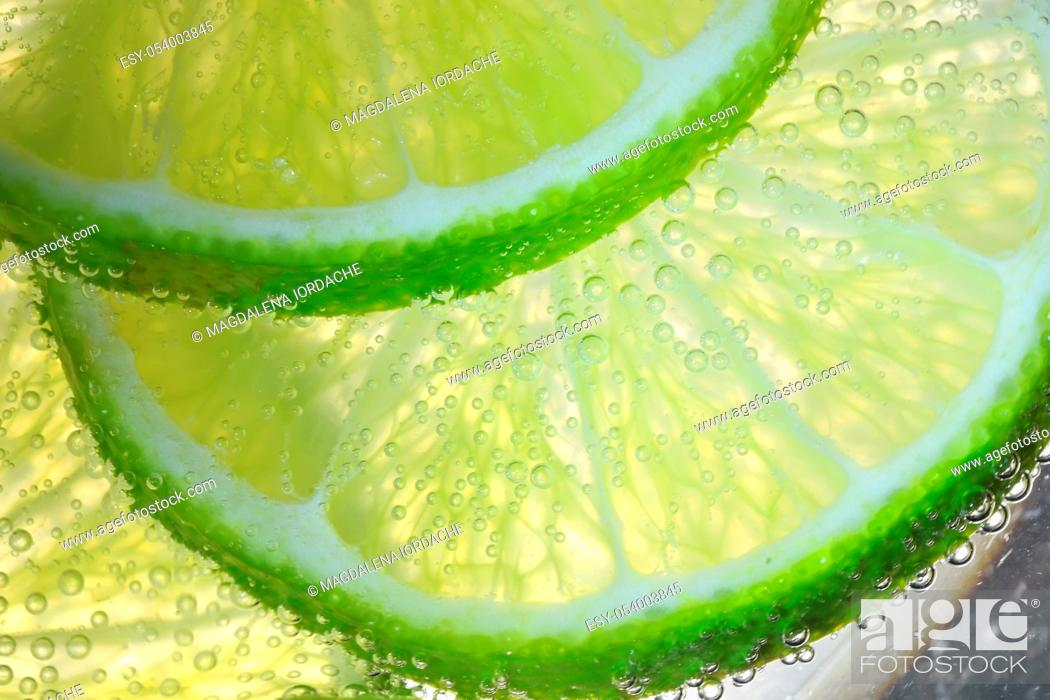 Stock Photo: Lemon Slices In Water With Air Bubbles.