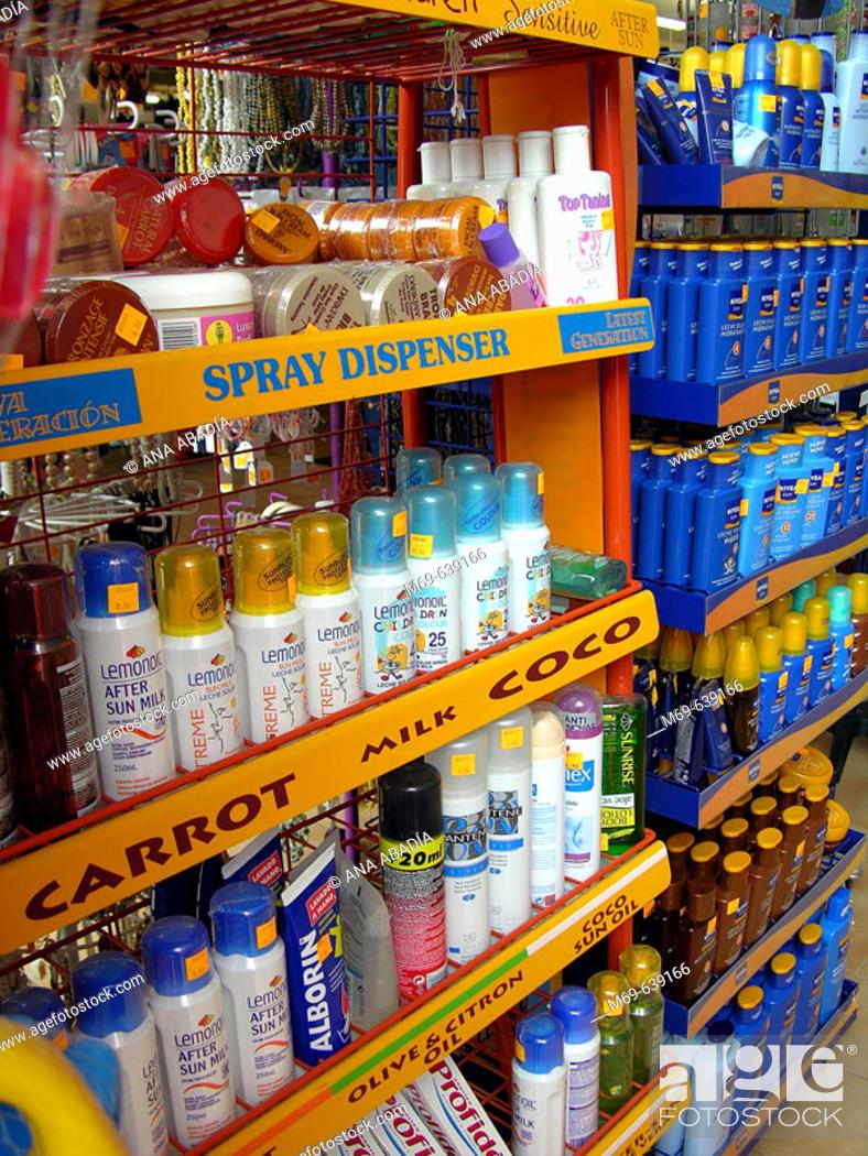 Stock Photo: Sun creams for sale.