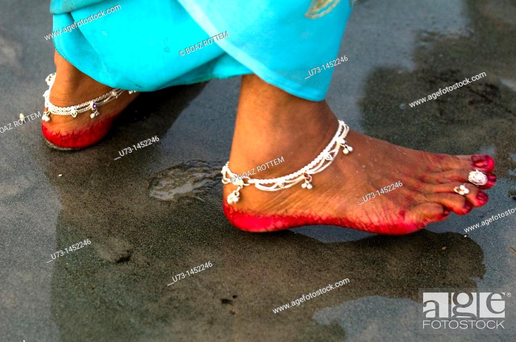 Stock Photo: Indian woman's feet decorated with anklet and red color.
