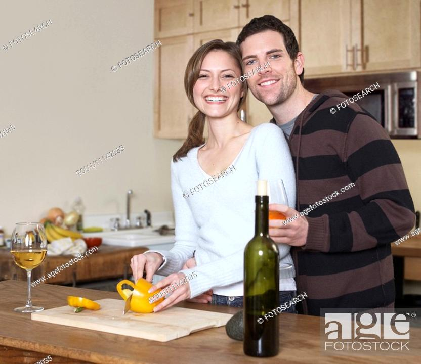 Stock Photo: Mid-Adult Couple Cooking.