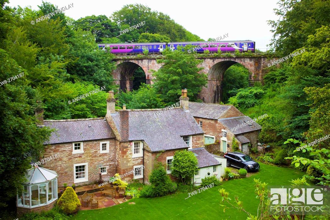 Stock Photo: Northern Rail Sprinter train. River Gelt Railway Bridge, Gelt Viaduct, Middle Gelt Bridge , Middle Gelt Viaduct, Brampton, Cumbria, England, United Kingdom.