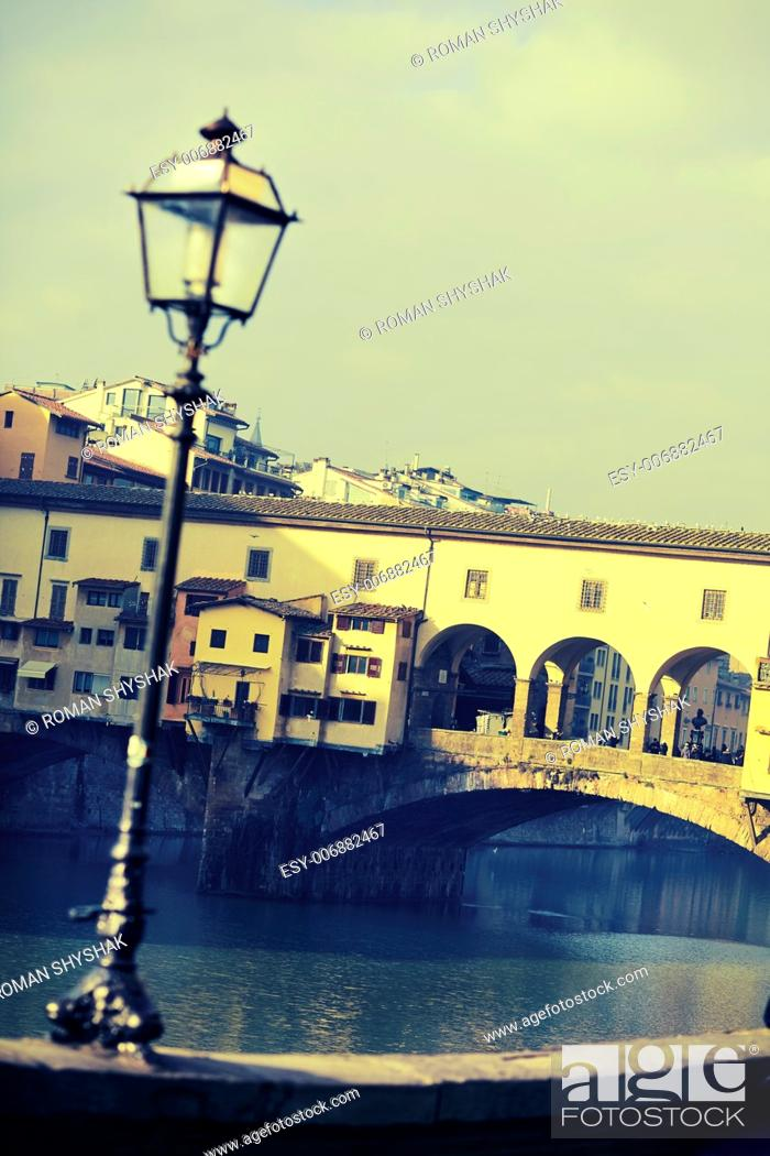 """Stock Photo: Street lamp in front of Ponte Vecchio. Photo executed in a range of """"""""cross processing""""""""."""