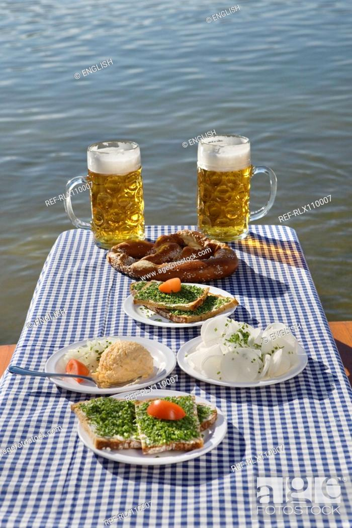 Stock Photo: Traditional Bavarian meal on table with beer in beer garden, Munich, Germany.