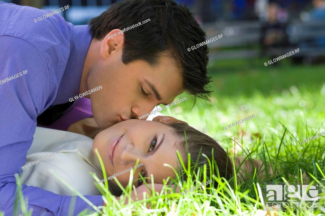 Stock Photo: Young couple romancing in a park.