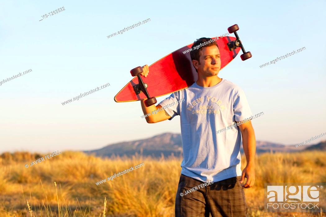 Stock Photo: Young Male posing with his skate board.