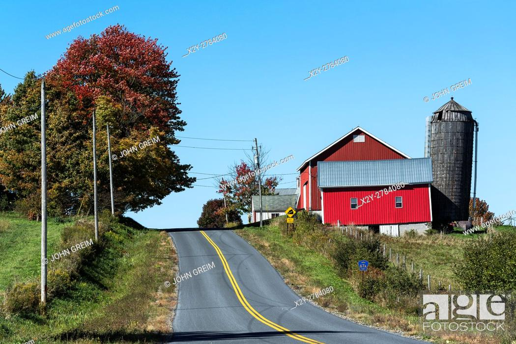 Stock Photo: Country road and red barn, Oneida County, New York, USA.