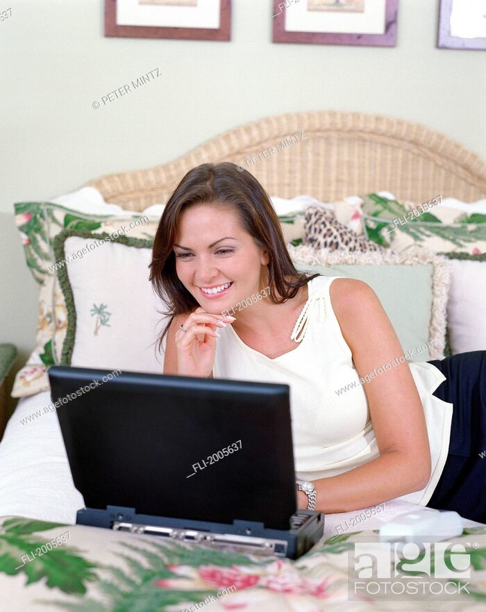 Stock Photo: Fv5438, Peter Mintz; Woman On Bed With Laptop.