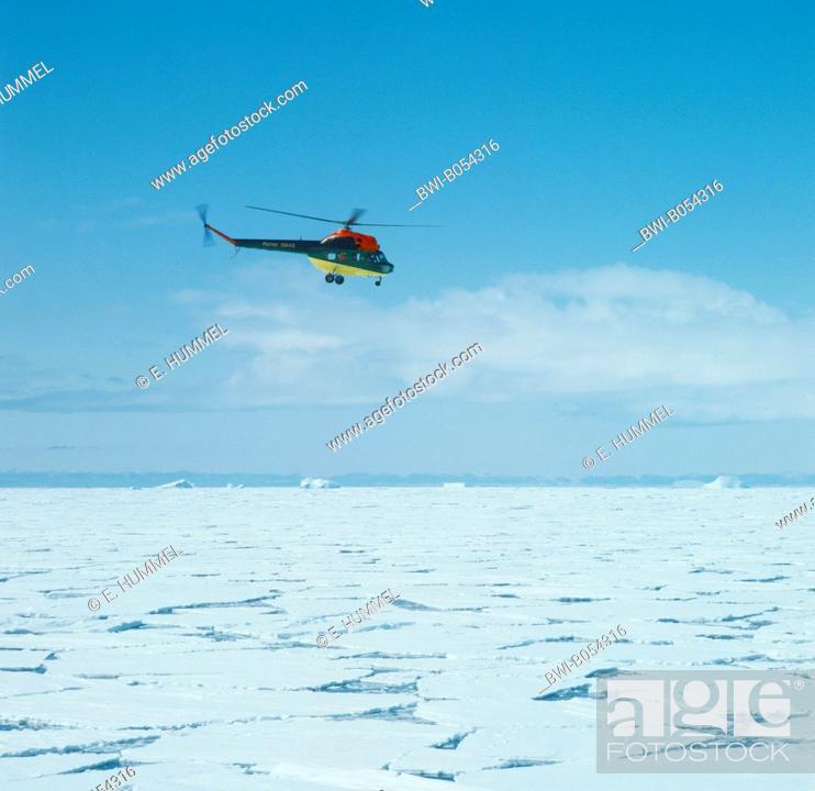 Imagen: russian MI 2 helicopter flying above drift ice, Antarctica.