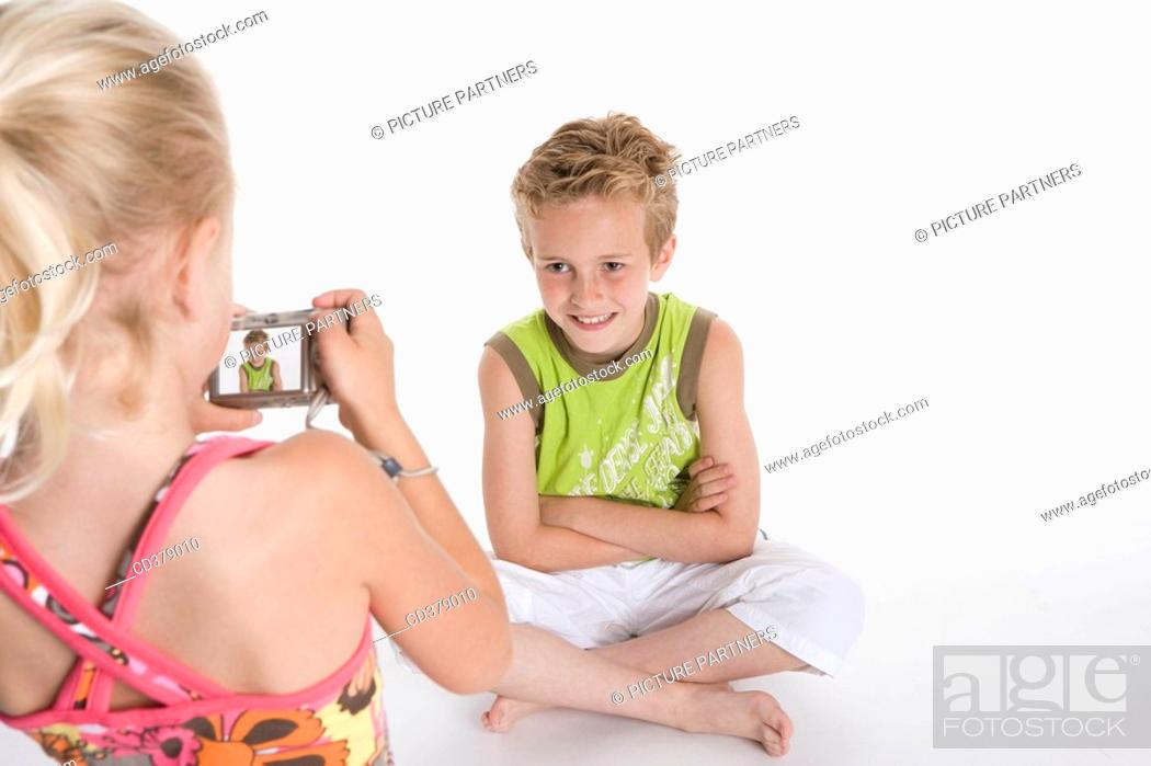 Stock Photo: Brother and sister making photos of each other.