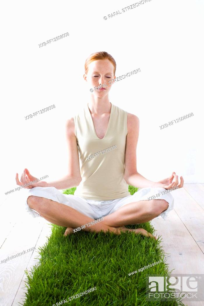 Stock Photo: young woman meditating.