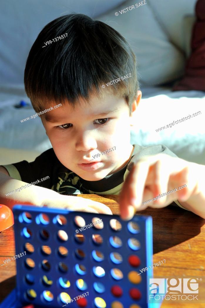 Stock Photo: child playing alone.