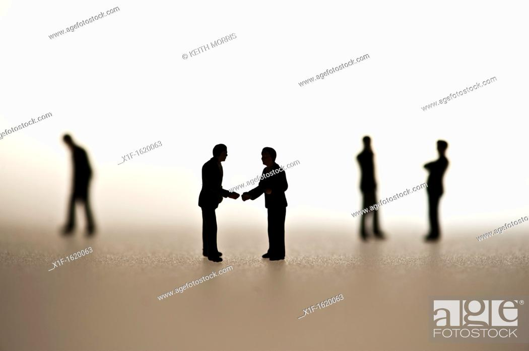 Stock Photo: silhouetted small figures conceptual image for business men meeting.