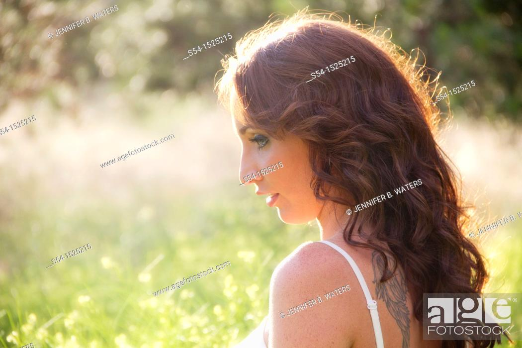 Stock Photo: A beautiful young caucasian woman outdoors in Spokane, Washington, USA.