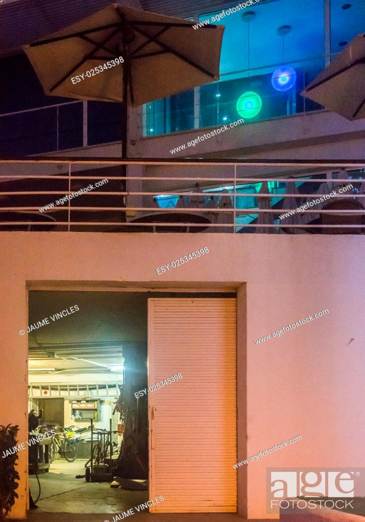 Stock Photo: Repair workshop on ground floor and bar-restaurant on the first floor of Port Balis, Barcelona Coast.