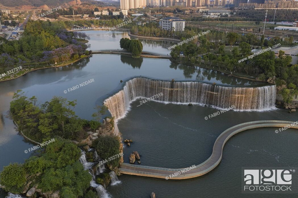 Stock Photo: Aerial 360 degree view of the Kunming Waterfall Park at sunset, one of the largest manamde waterfalls in the world.