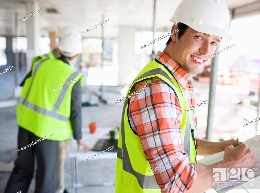 Stock Photo: Construction workers working on construction site.