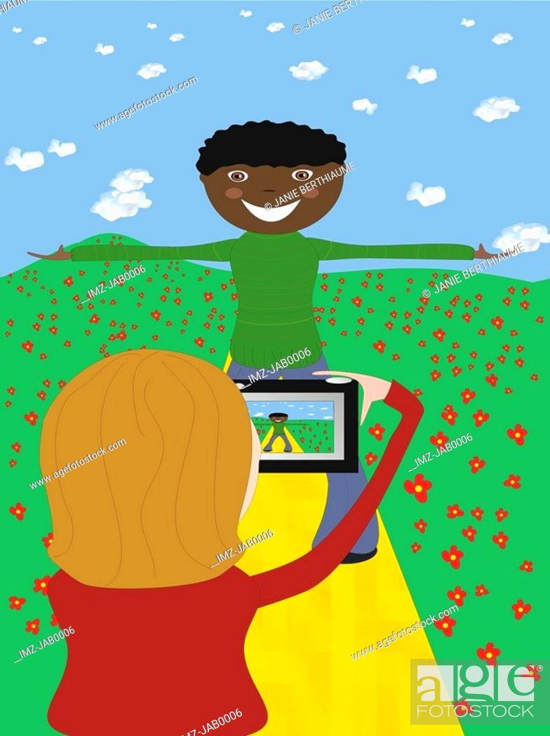 Stock Photo: A girl using a digital camera to take a photo of the boy.