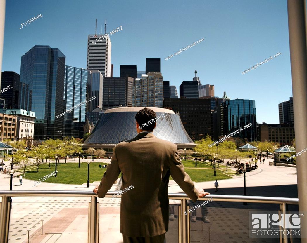 Stock Photo: Businessman Looking At City, Toronto, Ontario.