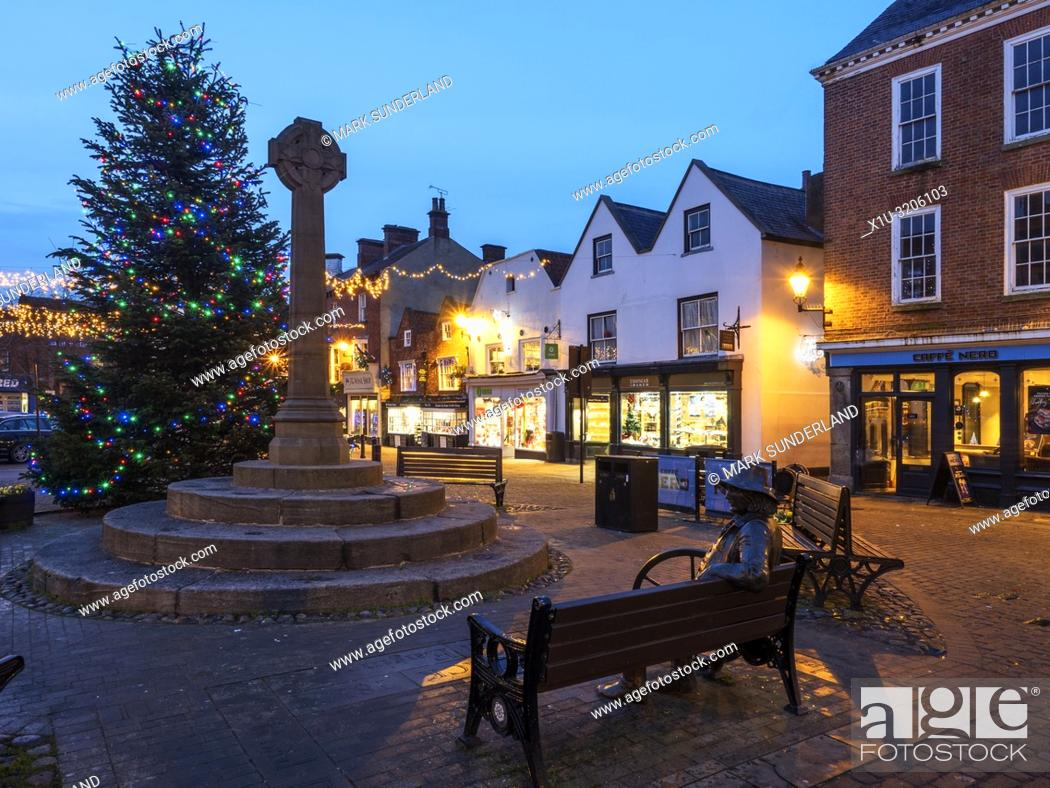 Stock Photo: Christmas tree and market cross in the Market Place at dusk Knaresborough North Yorkshire England.