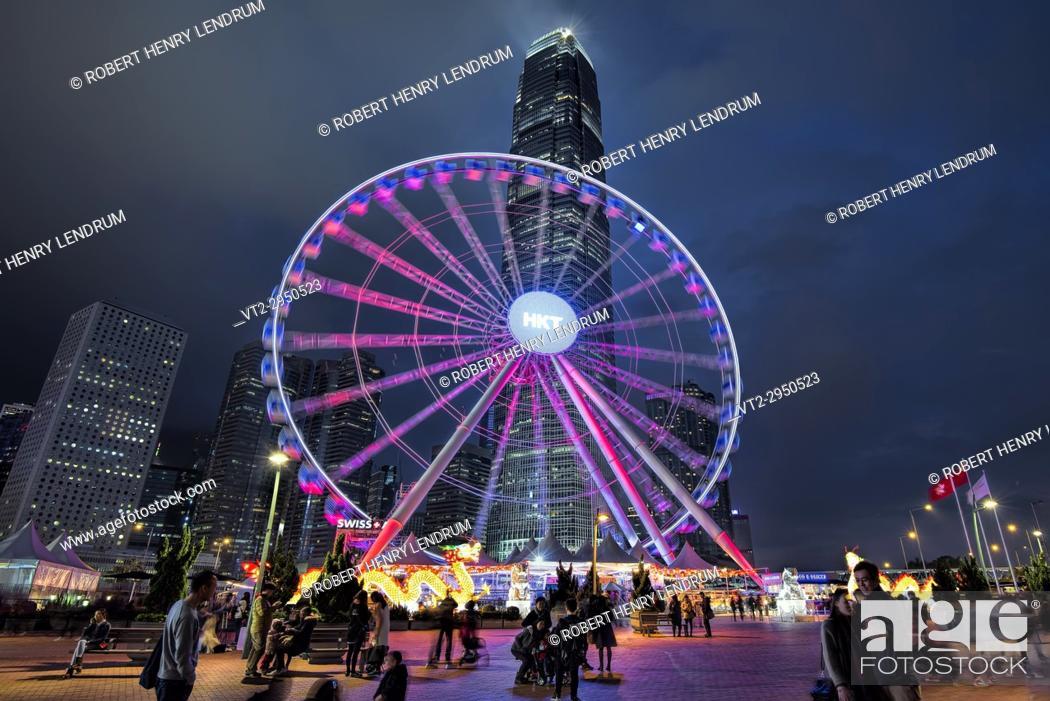 Stock Photo: Hong Kong observation wheel and the IFC2 building, Victoria harbor, Hong Kong, China.