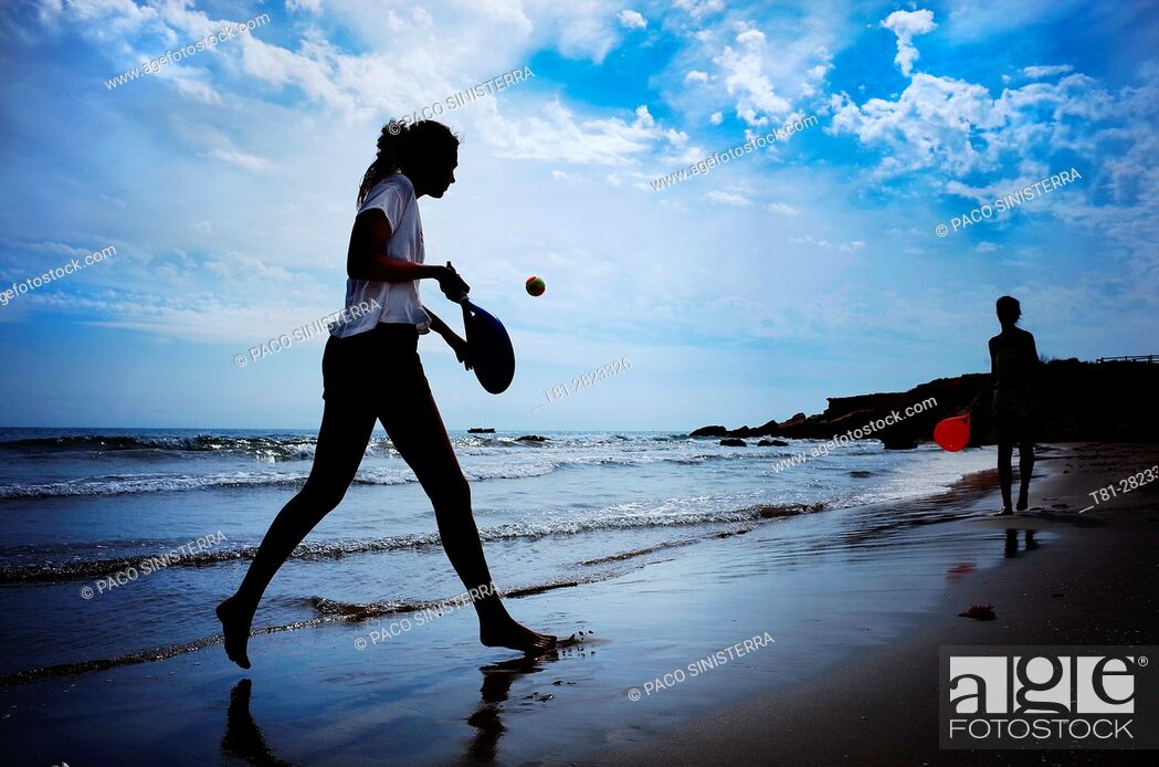 Stock Photo: Boy and girl playing paddle beach tennis on the beach of Alcocebre, Castellon province, Valencian Community, Spain.