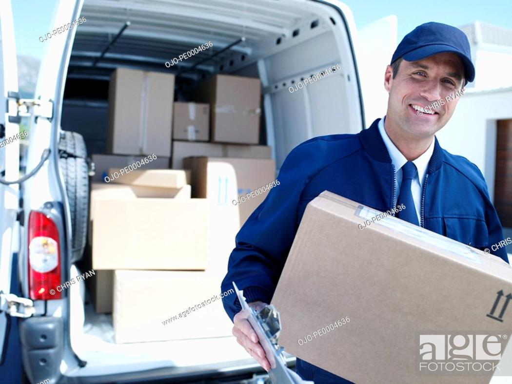 Stock Photo: Male delivery person in cap with van and boxes.