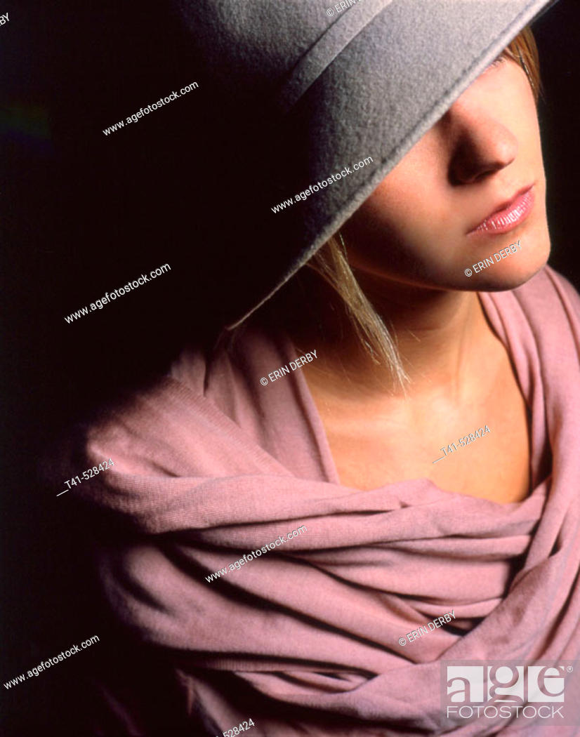 Stock Photo: Grey felt hat and pink cashmere wrap. Young lady fashion shot.