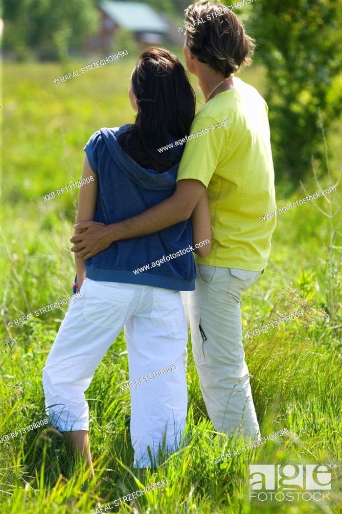 Stock Photo: couple on meadow.