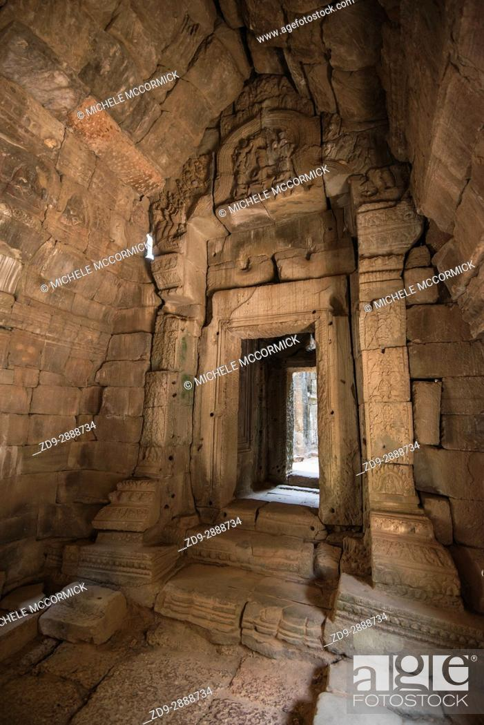 Stock Photo: A stone doorway at ancient Ta Prohm.