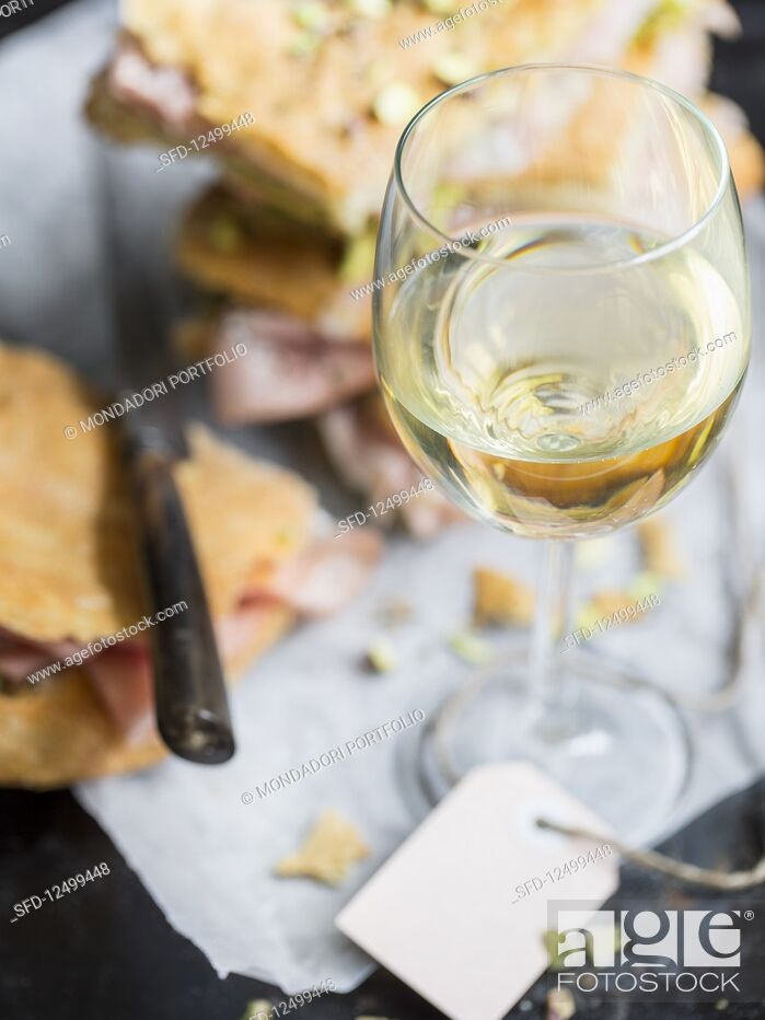 A Glass Of White Wine And Pizza Bread Stock Photo Picture And