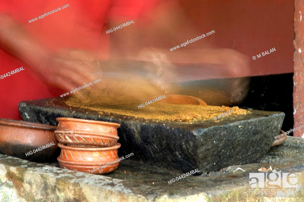 Stock Photo: PREPARING SPICES AND OTHER MATERIALS FOR KERALA CUISINE.