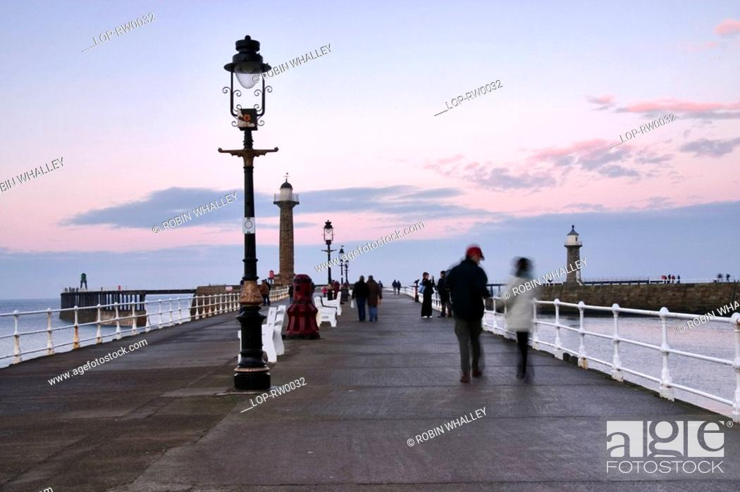 People on Whitby pier at sunset  A large portion of Bram Stoker's