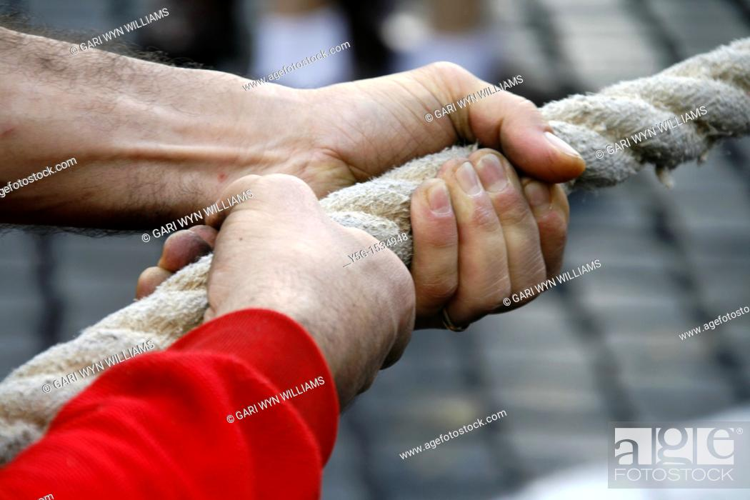 Stock Photo: close up of hand in tug of war competition.
