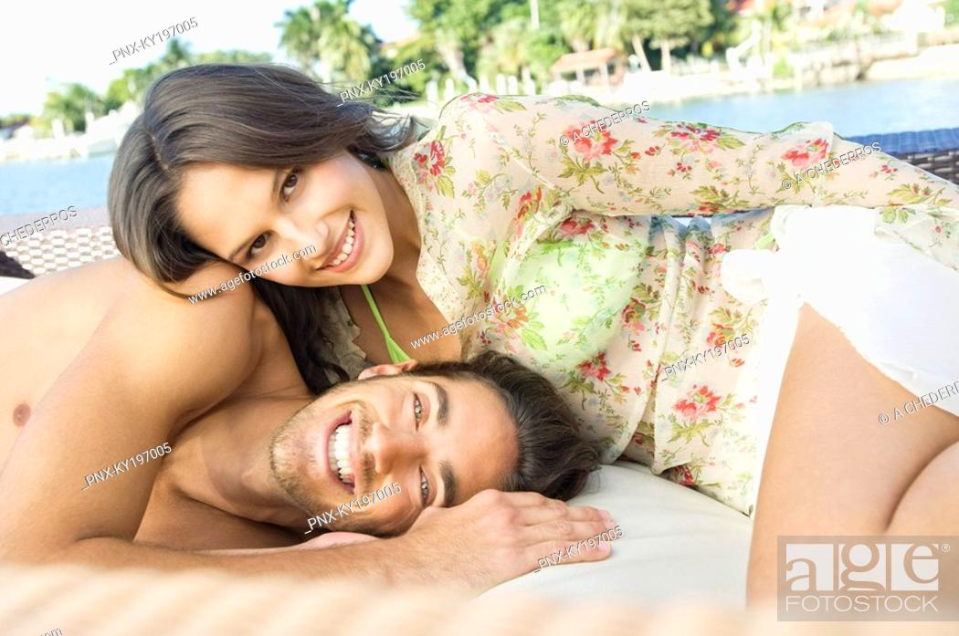 Stock Photo: Portrait of a couple resting at a tourist resort.