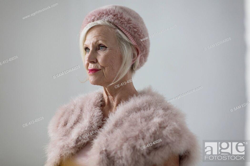 Stock Photo: Portrait elegant senior woman wearing fur.