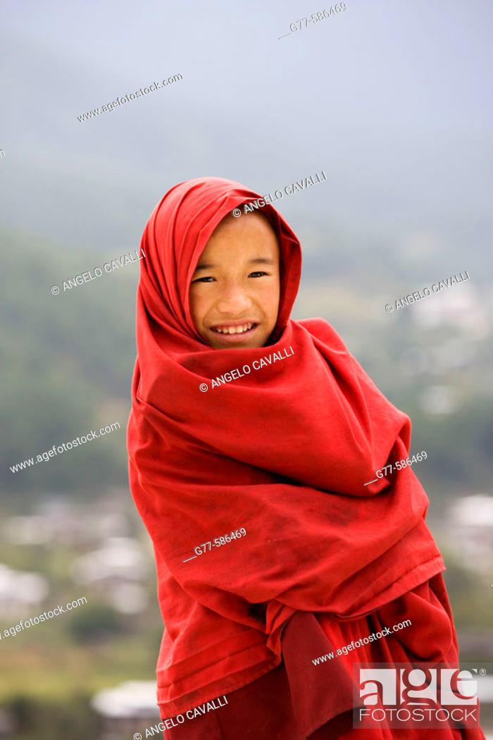 Stock Photo: Bhutan. Buthang Valley. Jankar. Tashing Goemba Monastery. Little Buddhist monk.