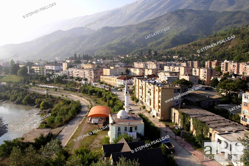 Stock Photo: Small town. Ottoman historical centre destroyed in WW2. Modern buildings. Mosque. River Vjosa. Dhembeli mountain.