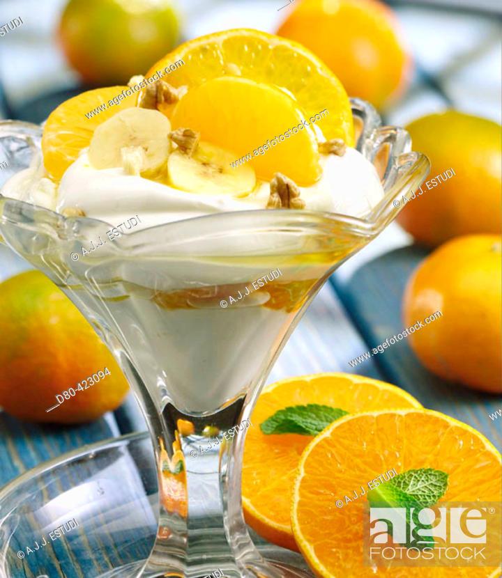 Stock Photo: Banana and tangerine glass.