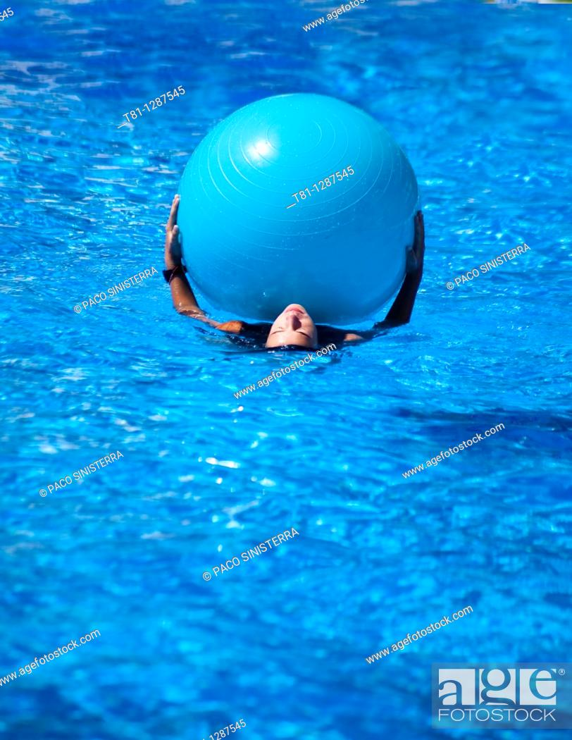 Stock Photo: girl swimming with ball.