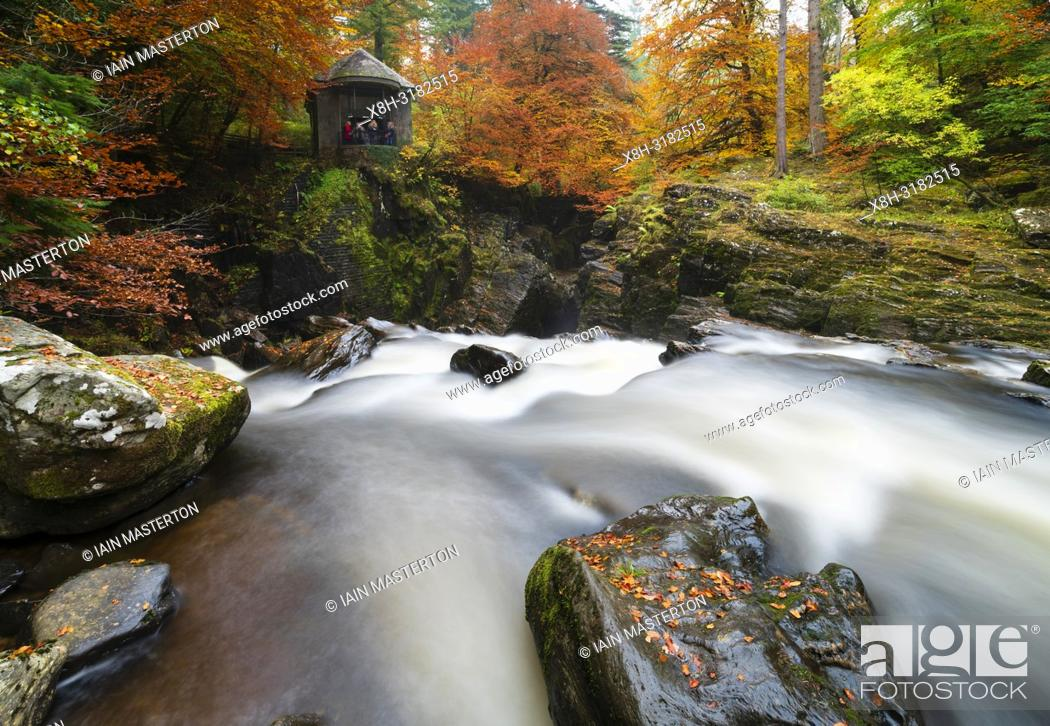 Stock Photo: Spectacular autumn colours at The Hermitage a famous beauty spot near Dunkeld in Perthshire. Pictured is Ossian's Hall overlooking the River Braan.