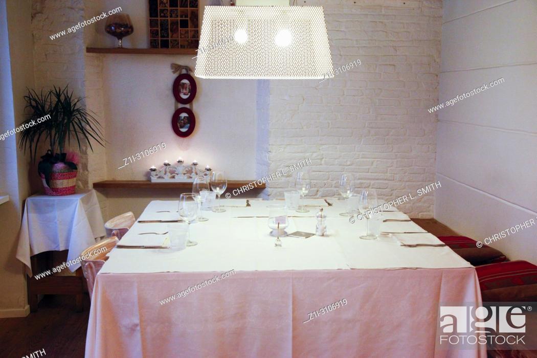 Stock Photo: Inside the Trattoria Antica Maddalena restaurant on Via Pelliccerie in Udine, Italy.