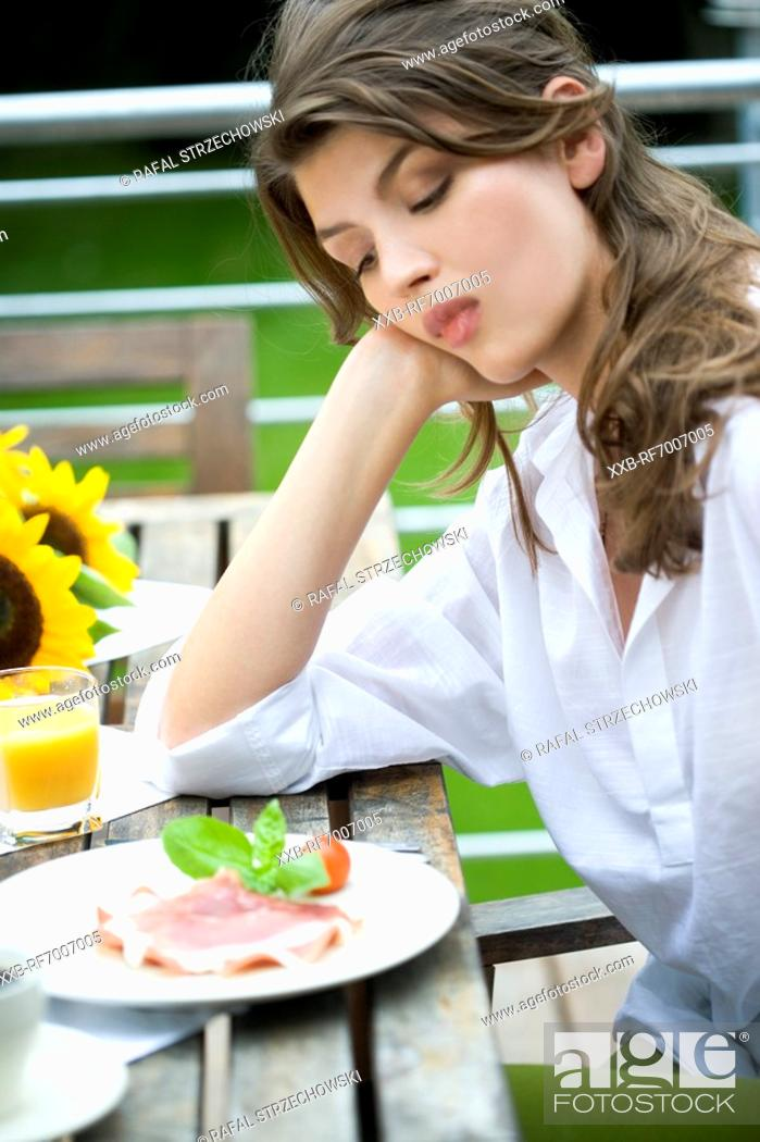 Stock Photo: Woman sitting on the terrace.