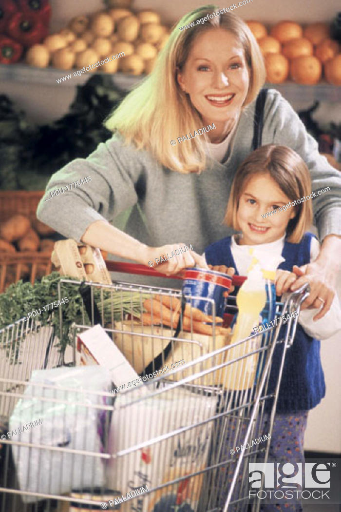 Stock Photo: Mother and daughter grocery shopping (portrait).