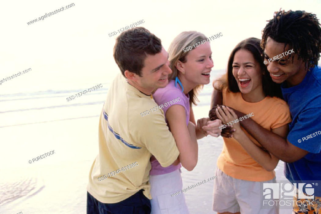 Stock Photo: Two teenager couples at the beach.