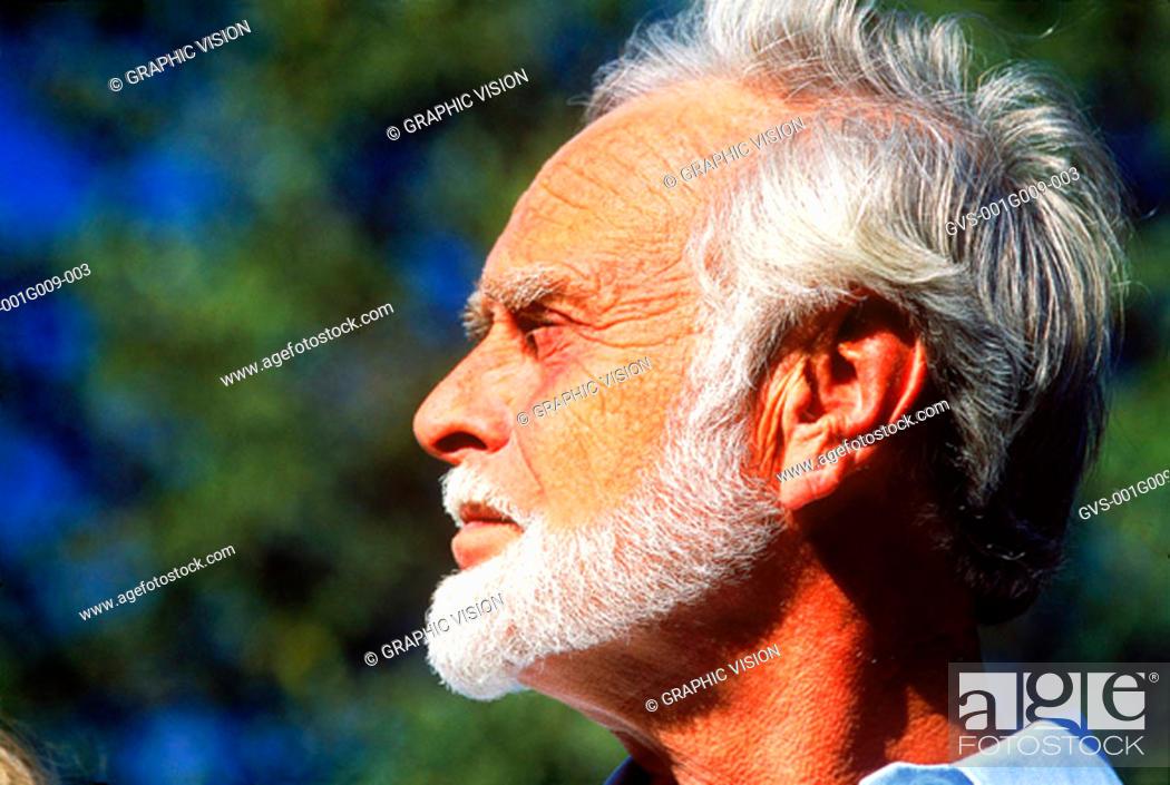 Stock Photo: Old man looking ahead.